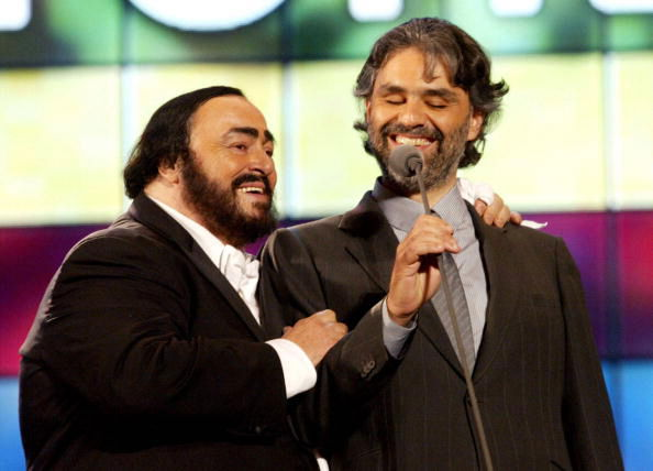 Italian tenor Luciano Pavarotti (L) with